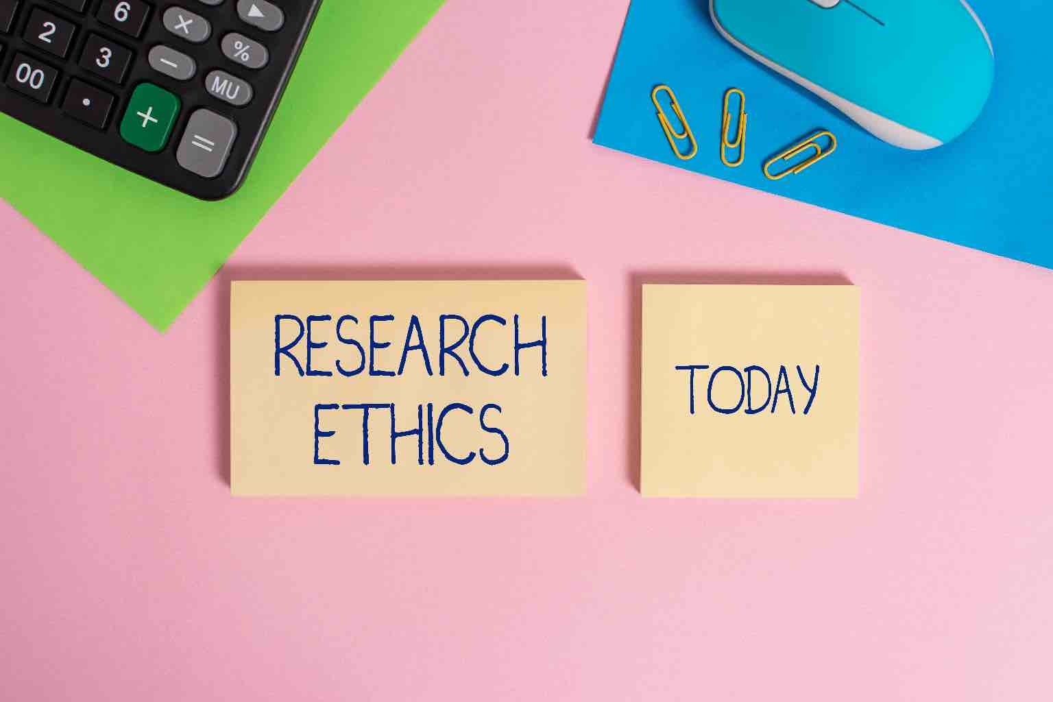 """Two post-it notes on a desktop mat read """"RESEARCH ETHICS"""" and """"TODAY"""""""