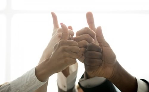 A diverse group of hands with thumbs up